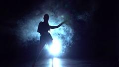 Girl dancing latin dance in the studio, silhouette. Slow motion Arkistovideo