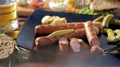 Eating a tasty bratwurst with a fork during a breakfast. Warm and tasty mood Stock Footage