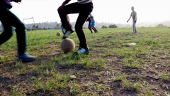 Rural young soccer players playing football on a soccer field Stock Footage