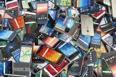 Choose mobile phone. Heap of the different smartphones Stock Illustration