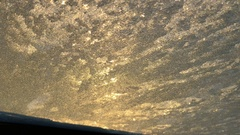 Scraping off frost from a car windscreen Stock Footage