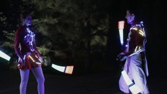 LED people performance in night city Stock Footage