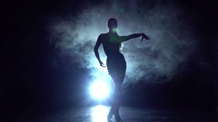 Sport - ballroom dance in the studio, silhouette. Slow motion Stock Footage