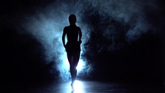 Girl dancing movements of salsa, rumba. background illuminated. Slow motion Arkistovideo