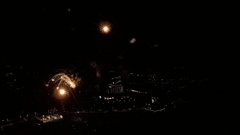 AERIAL: Flying inside big fireworks above the city Stock Footage
