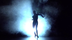 Girl dancing elements of sport - ballroom dance in the studio, silhouette. Slow Stock Footage