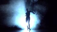 Girl dancing elements of sport - ballroom dance in the studio, silhouette. Slow Stock Footage