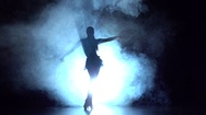 Dancer performs latin dance in the studio, silhouette. Slow motion Stock Footage