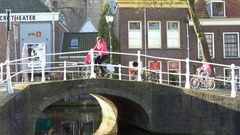 Busy Bicycle Traffic Over Canal Bridge in Delft, the Netherlands Stock Footage