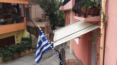 Greek flag in the old town Stock Footage