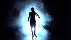 Latin dance in the studio, silhouette. Slow motion Stock Footage