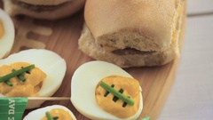 Football deviled eggs for Game day party. Stock Footage