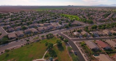 Flyover Establishing Shot Typical Arizona Neighborhood and Public Park  	 Stock Footage