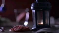 Cocktail Grapefruit, candle, fir branch with christmas toys and candy canes. Stock Footage