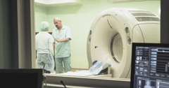 Doctor helps woman to use CT MRI scanning 4k video. Patient computed tomography Stock Footage