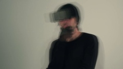 Accelerated confused male in virtual reality environment wearing vr goggles Stock Footage