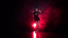 Girl dancing elements of samba in the studio. Slow motion Stock Footage