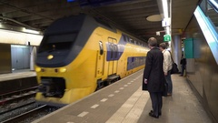 A Businessman Boards a Train to Amsterdam from Delft, the Netherlands in 4K Stock Footage