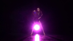 Girl dancing elements of cha-cha-cha dance in the studio. Slow motion Stock Footage