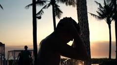 Young boy washing head under shower in garden in resort, super slow motion 240fp Stock Footage