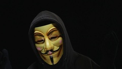 4K Anonymous Mask Man Talking  - Black Background Stock Footage