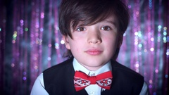 4K Disco Christmas Shot of Child Blowing Confetti and Glitter Stock Footage