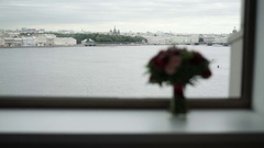 Bouquet near window in hotel Stock Footage
