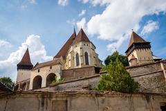 Saxon village with fortified church in Transylvania. Biertan castle in Romania Stock Photos