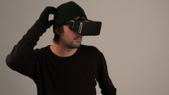 Male actor in virtual reality environment wearing vr goggles Stock Footage