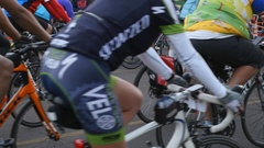Bicycle riders at the start of a bike race Stock Footage