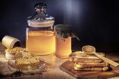 Toasts and honey Stock Photos