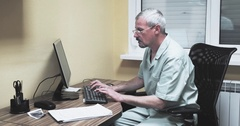 Doctor working at computer 4k video. Medic looking at monitor typing on keyboard Stock Footage