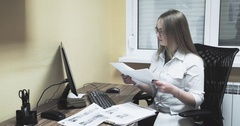 Female doctor nurse working at computer with papers 4k video. Hospital clinic Stock Footage