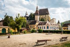 Saxon village with fortified church in Transylvania. Biertan castle in Romania Stock Photos