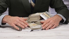 4K Businessman With Pile of Cash Money on his Desk Stock Footage