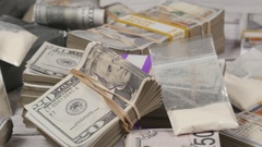 4K Closeup Cocaine Drugs and Cash Stacks on a Table Stock Footage