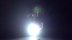 Girl dancing cha-cha-cha on a dark background with light illuminator. Slow Stock Footage