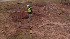 Electrician engineer check the excavation pit for electrical cables Stock Footage