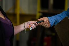 Auto repair mechanic being handed keys from female customer Stock Photos