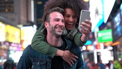 Couple at Times Square taking selfie picture Stock Footage