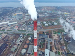 Large pipes smoking in a industrial area. Thermal power plant. Aerial Stock Footage