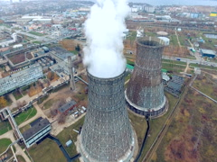 Smoking chimneys, pipe at a thermal power plant. Aerial view made from copter Stock Footage