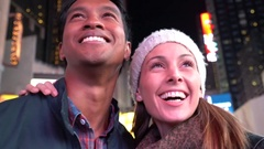 Couple at Times Square laughing outloud Stock Footage