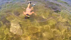 Two teenagers dive into the sea 2 Stock Footage