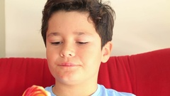 Young cute boy with big colorful lollipop candy 2 Stock Footage