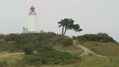 People visiting lighthouse of Hiddensee isle (Germany) Stock Footage