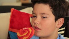 Young cute boy with big colorful lollipop candy 5 Stock Footage