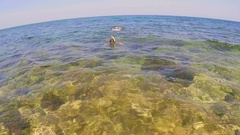 Two teenagers dive into the sea 3 Stock Footage