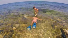 Two teenagers dive into the sea 4 Stock Footage
