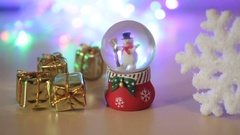 Snowman and toy gifts on a light background Stock Footage